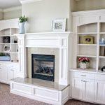 White mantle and bookshelves