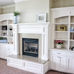 White mantle and bookshelves